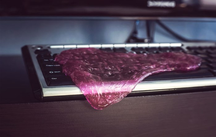 Cleaning a keyboard with special keyboard-cleaning goop
