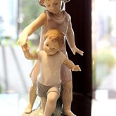 Lladro Let Me Help You available at Albert F. Rhodes Jewelers